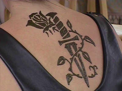 Large rose and knife back piece immediately following for Rose henna tattoo